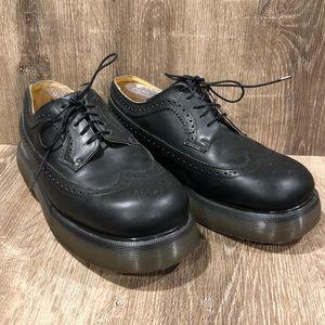 Dr. Martens wingtip shoes